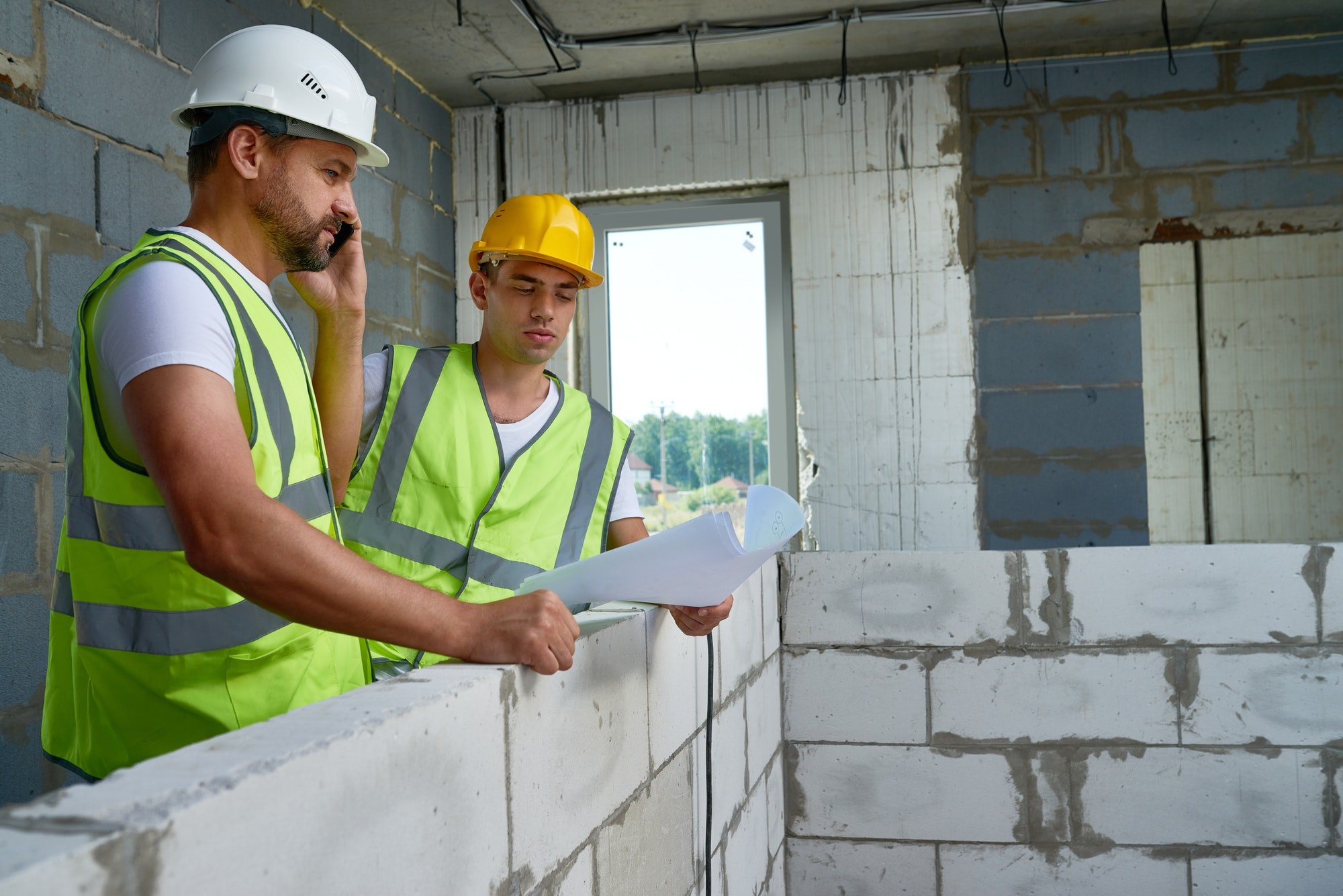 Two Workers with Floor Plans preparing for builders clean